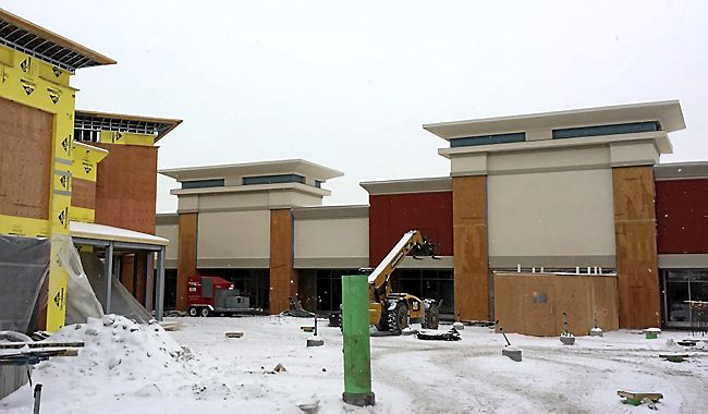 Construction of the Eagan outlet mall began in June 2013. Developer Paragon says the ground-up project involves some 400 construction jobs as well as some 2,000 permanent jobs when it celebrates its grand opening this summer. (Photo courtesy Paragon Outlets)